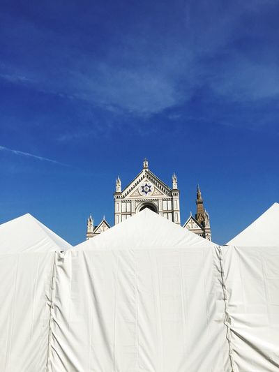 Santa Croce cathedral in florence behind market tents Tent Market Santa Croce Santa Croce Cathedral Florence EyeEm Selects Architecture Built Structure Blue Sky Religion Place Of Worship No People Day Spirituality Building Exterior Belief Building Low Angle View Nature Travel Destinations Travel White Color Snowcapped Mountain