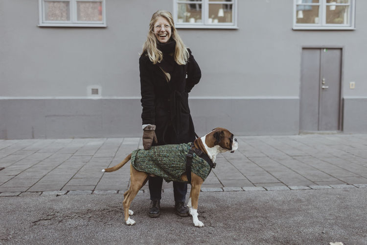 Full length of woman with dog