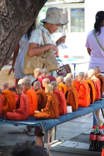 Arrangement Casual Clothing Collection Cultures Day Focus On Foreground For Sale Lifestyles Market Market Stall Monks Orange Puppies Retail  Sale Small Business Variation