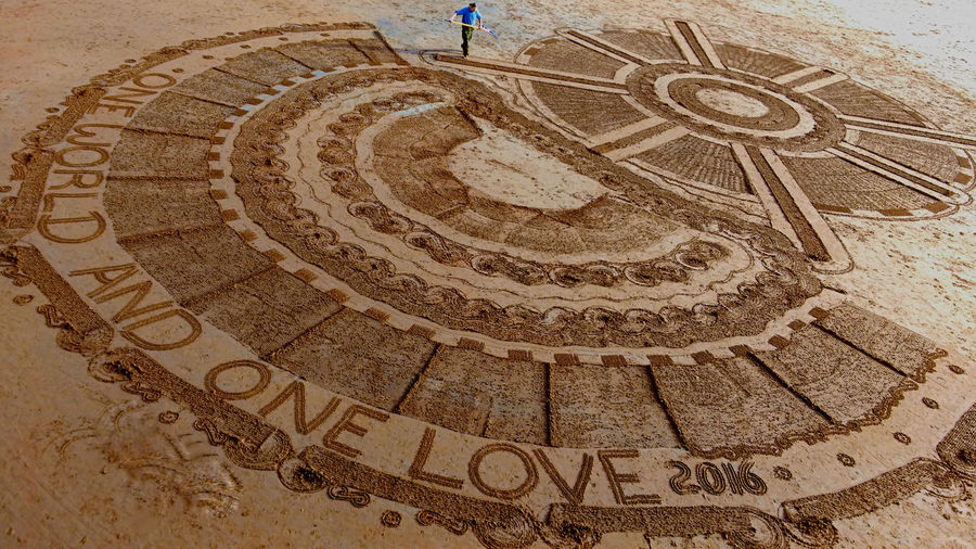 A Man On The Beach Art Art And Craft Artist Beach Art Creativity Design I saw this today and had to get a picture One World And One Love Pattern Sand Art Talent Showcase: January