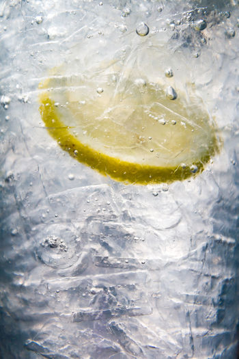 Close-up of lemon in water