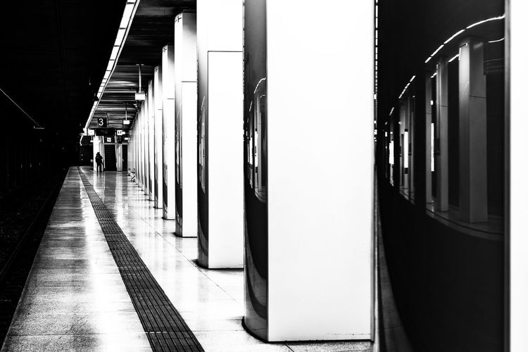 railroad station platform Bnw Black And White One Man Only Real People darkness and light Artifical Light Hamburg Altona Platform Reflection Long Exposure Architecture Public Transportation Rail Transportation Transportation Mode Of Transportation Railroad Station The Way Forward Railroad Station Platform Indoors  Incidental People Train Direction Built Structure Illuminated Train - Vehicle Flooring Travel In A Row Architectural Column Subway Train Tiled Floor