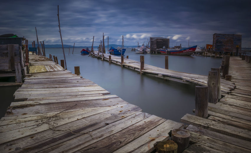 Architecture Built Structure Cloud - Sky Day Jetty Marina Nature Nautical Vessel No People Outdoors Pier Post Sea Sky Tranquility Transportation Water Wood Wood - Material Wood Paneling Wooden Post