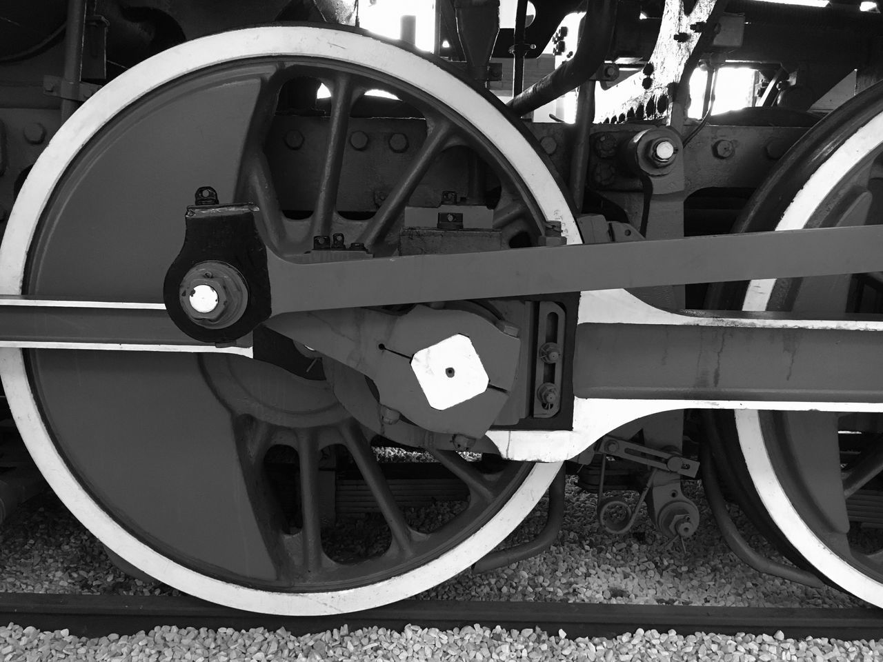 transportation, mode of transportation, wheel, land vehicle, no people, close-up, metal, rail transportation, track, day, railroad track, outdoors, machinery, public transportation, train, circle, shape, architecture, travel, focus on foreground