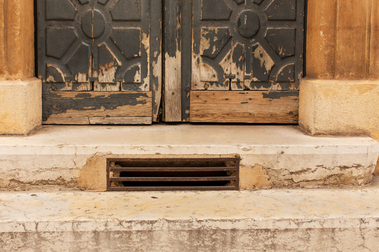 Low section of a door seen at the Old city, Aix-en-Provence Architecture Building Exterior Built Structure Close-up Closed Day Door Entrance Entryway Front Door Metal No People Old Town Outdoors Steps Wood - Material Wrought Iron