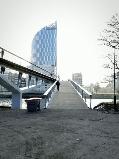 You never walk alone... The city is yours ! Oneway Suspension Bridge Outdoors Water Connection City Sky Architecture Cityscape Liège Bovery Sameway On Road Again