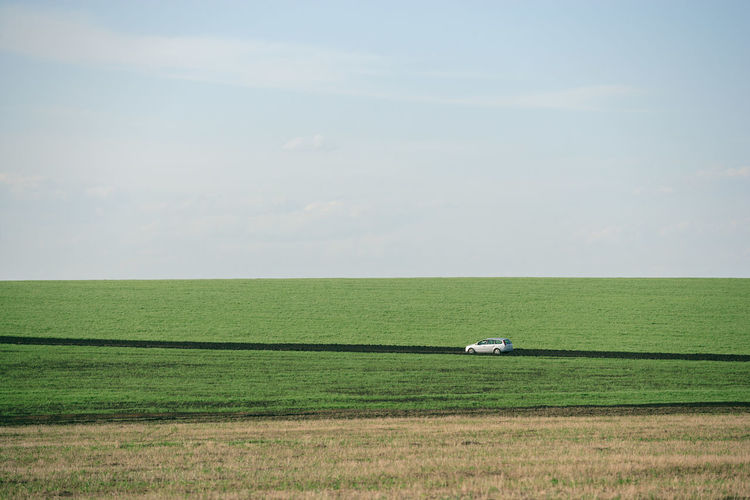 Country Road Road Agriculture Car Day Environment Field Grass Green Color Horizon Land Landscape Minimalism Outdoors Sky Tranquil Scene Tranquility Transportation My Best Photo 17.62°