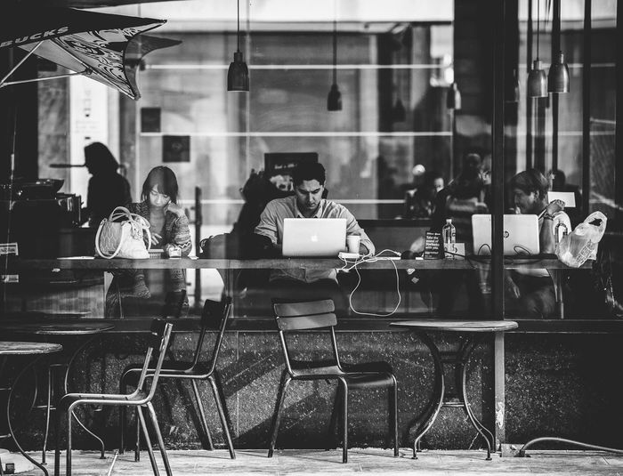In Modern Times... Taking Photos Black And White Street Photography Urbanphotography City Life People People Watching Atlanta Photographyisthemuse Nikon D750 Tamron 70-200mm F/2.8 Natural Light Candid Photography Coffee Shop Starbucks Storefront Looking Down Laptops The Street Photographer - 2016 EyeEm Awards