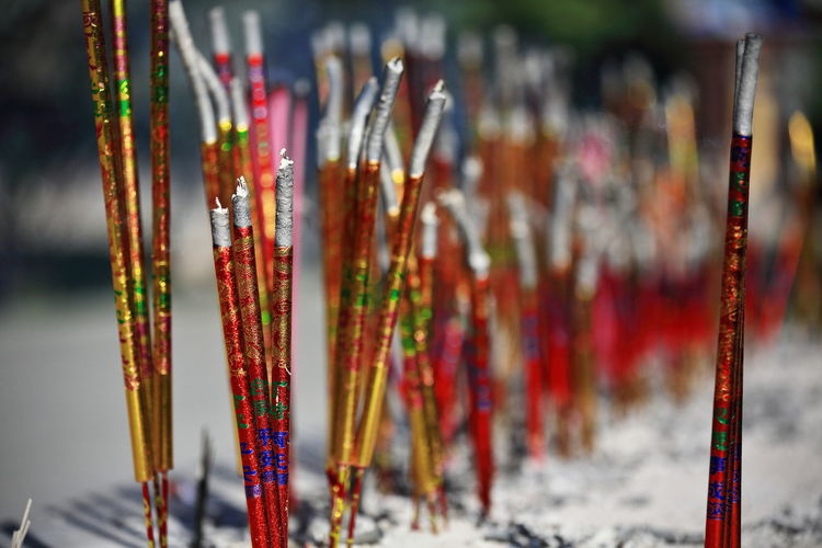 Extinguished incense sticks and ashes-red golden glossy paper-dafo si great buddha temple-china-1282