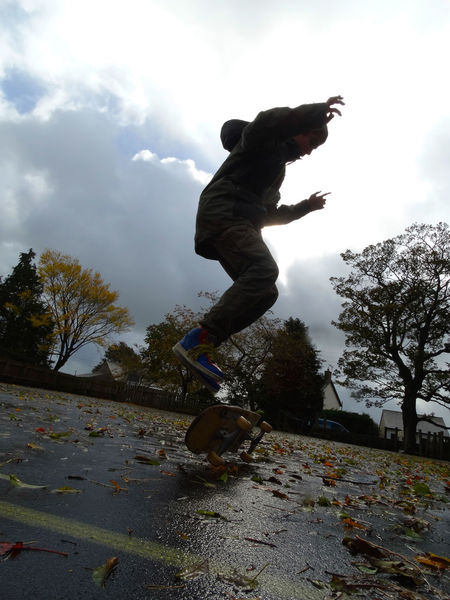 Autumn Balance Boy Boy Skateboarding In Autumn Leisure Activity Lifestyles Men Outdoors Park Real People Side View Skateboard Teenager