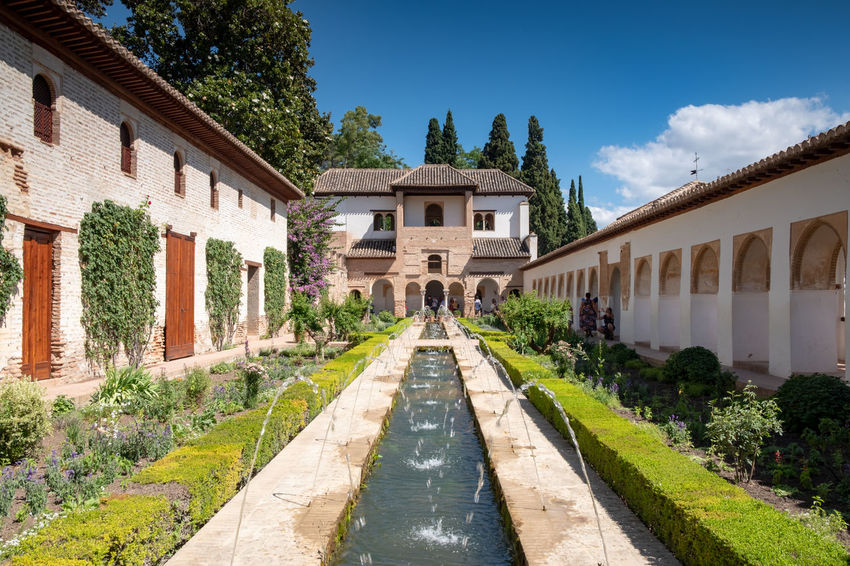 Alhambra (Granada) Alhambra De Granada  Granada Granada, Spain Alhambra Architecture Building Building Exterior Built Structure Cloud - Sky Day Direction Grass House Luxury Nature No People Outdoors Plant Residential District Sky Sunlight The Way Forward Tree Water