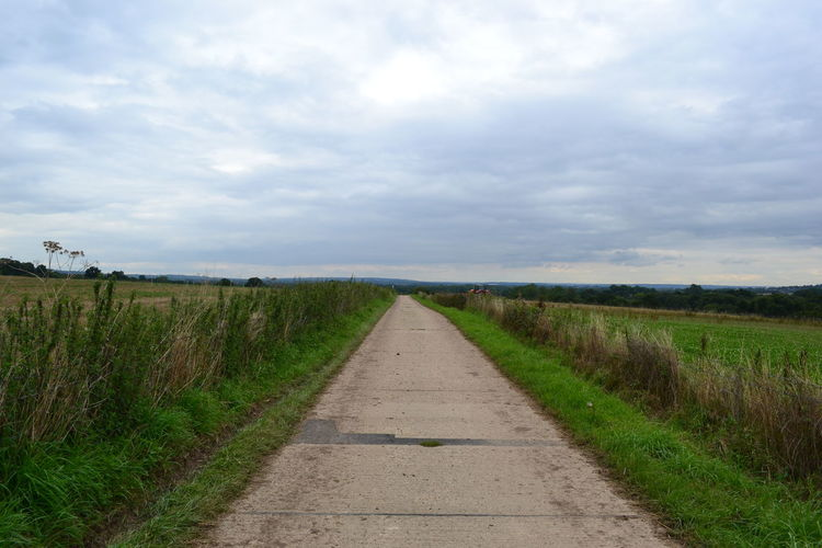 Country Road Countryside Field Grass Landscape Narrow Outdoors Perspective Remote Road Rural Scene Sky Vanishing Point