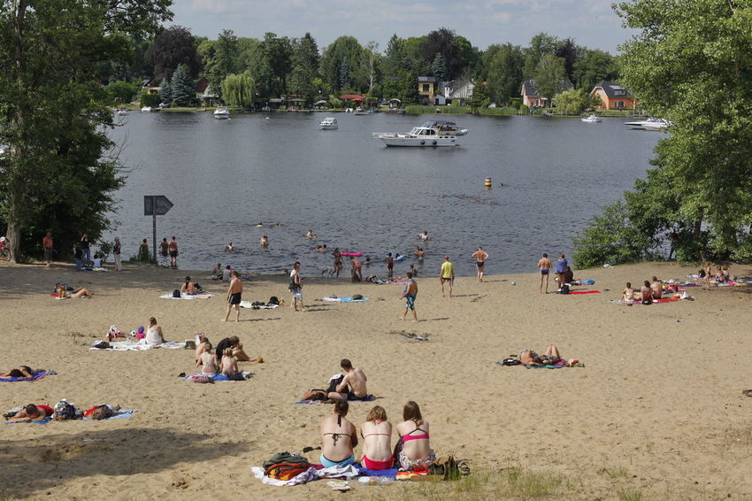 Kleiner Müggelsee Adult Beach Crowd Day Enjoyment Fun Kleiner Müggelsee Large Group Of People Leisure Activity Lifestyles Men Mixed Age Range Nature Outdoors People Real People Riverbank Sand Sitting Sky Summer Tree Vacations Water Women