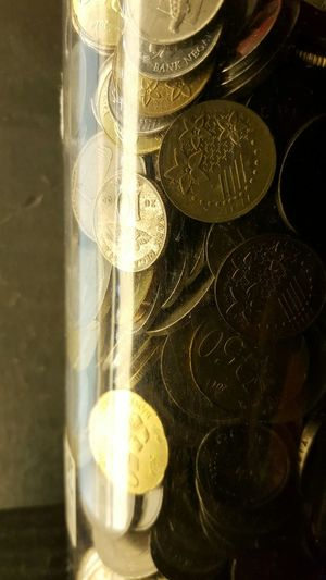 Coins in glass container