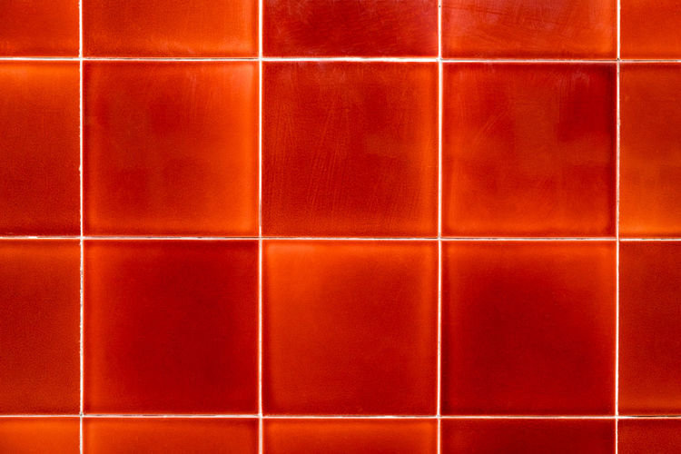 Tile Backgrounds Pattern Indoors  Square Shape No People Full Frame Geometric Shape Close-up Shape Repetition Grid Design Wall - Building Feature Checked Pattern Side By Side Red Wall Tiled Floor Glowing Orange Color Copy Space In A Row Parallel Lines Bathroom
