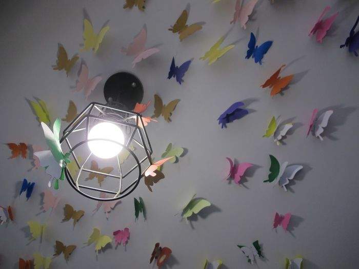 Close-up of illuminated light bulbs hanging on wall