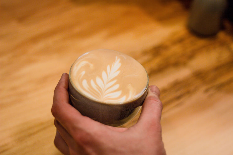 Human Hand Hand Holding Human Body Part One Person Real People Food And Drink Indoors  Cup Drink Refreshment Lifestyles Unrecognizable Person Focus On Foreground Close-up Frothy Drink Body Part Froth Art Coffee Cup Latte Hot Drink Finger Coffee Coffee - Drink Coffee Time