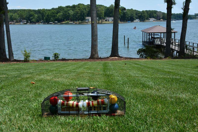 Lakeside croquet set on grass lawn