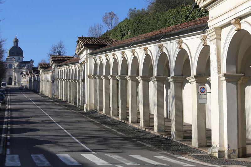 Corridor of building against sky in city