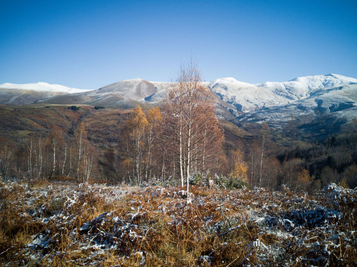 Scenic view mountains during first winter days