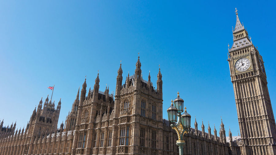 Palace of Westminster, Westminster Blue Sky Clear Sky Low Angle View Parliament Building Building Exterior Architecture No People England, UK United Kingdom London Palace Of Westminster Clock Tower Big Ben Street Lamps
