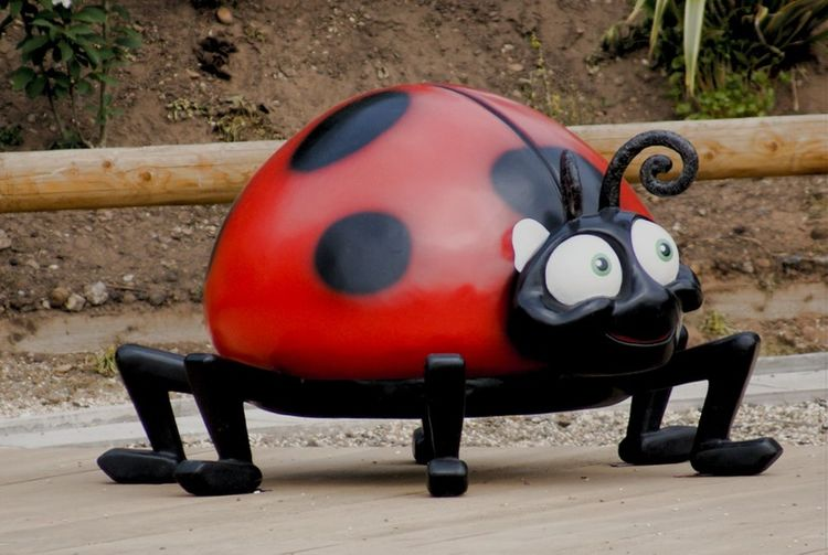 Statue Ladybird Ladybug Play Thing Cartoon No People Day Outdoors Childhood Nature Close-up