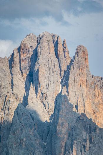 Scenic view of sassolungo langkofel peak in summer against sky