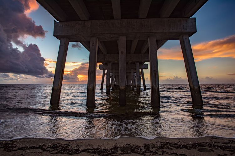 Sunrise And Clouds Sunrise EyeEm Selects Sky Water Built Structure Sea Sunset Architecture Beach Pier Nature Bridge Horizon Over Water Bridge - Man Made Structure Horizon Underneath Cloud - Sky Scenics - Nature
