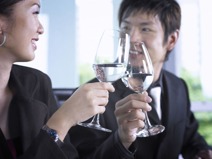 Business colleagues with wineglass at office