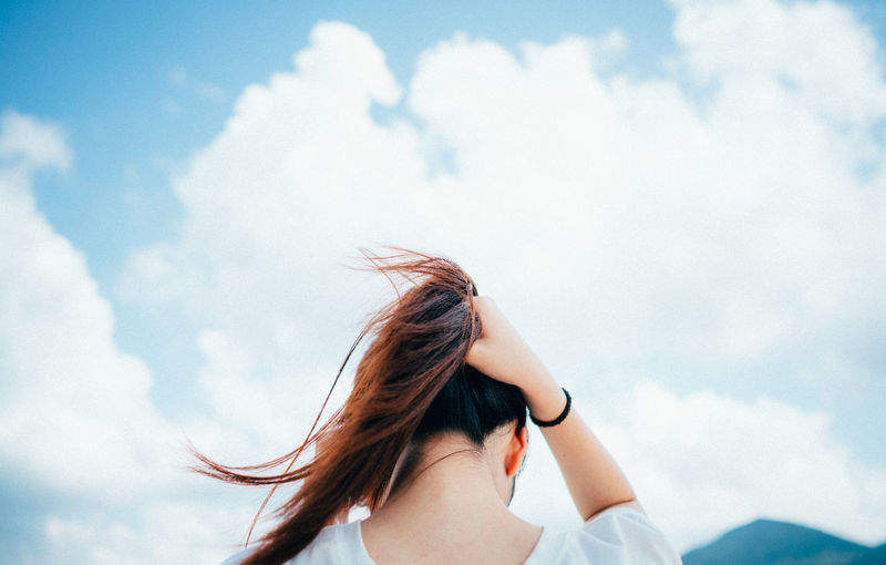 Tie hair Adult Adults Only Beautiful Woman Cloud - Sky Day Freedom Hair Toss Headshot Long Hair Low Angle View Nature One Person One Woman Only One Young Woman Only Only Women Outdoors People Sky Women Young Adult Young Women