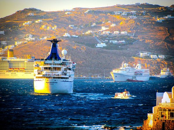 The Tourist. Cruise Ships in the Port of Mykonos in the Evening Light. Shades Of Blue Showcase: February Share Your Adventure Summer Holidays The Best From Holiday POV Greek Islands Summer Memories 🌄 Cruising Houses Village Island Blue Sea Waves Cruise Ship Pastel Power No People Golden Hour Yellowmagic On A Boat Summer Views