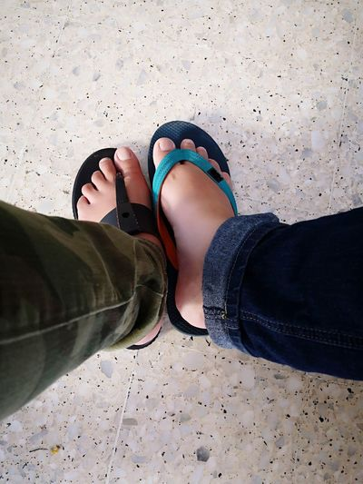 Two different foot wearing slippers, green denim, blue denim, terrazzo floor Terazzo Slippers Friends Friendship Two People Two In One Togetherness Same  Same But Different