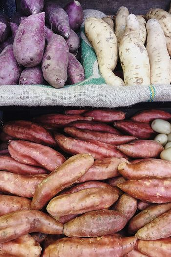 High angle view of sweet potatoes for sale at market