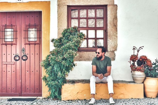 Sitting Door Mid Adult One Person Full Length Day Plant One Man Only Casual Clothing Handsome Building Exterior Real People Only Men Built Structure Architecture Lifestyles Young Adult Men Outdoors Adult Colour Your Horizn