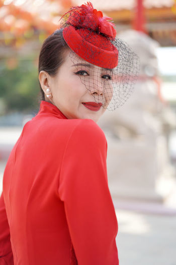 Portrait of woman in red hat