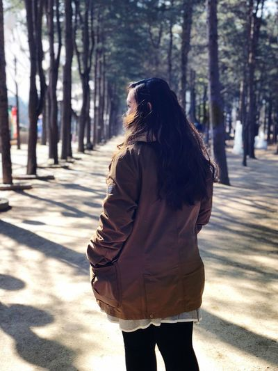 Girl in Nami Korea Winter Travel Nami Island Women Three Quarter Length Sunlight One Person Nature Adult Hairstyle Tree Shadow Standing