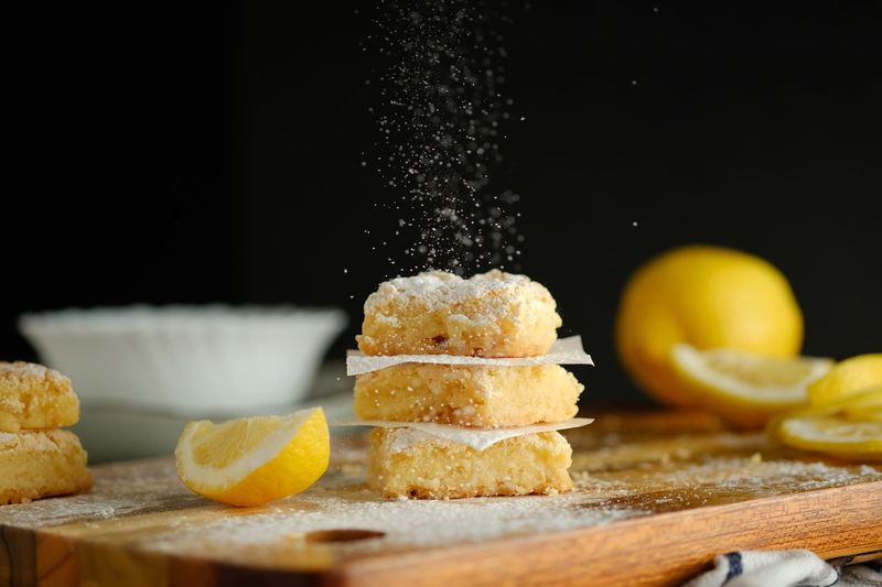 Lemon Squares Sweet Food EyeEm Selects Food And Drink Food Freshness Indoors  Fruit Healthy Eating Lemon Sweet Food Yellow Selective Focus Cutting Board Still Life Table Wood - Material Preparation  No People Citrus Fruit Close-up SLICE First Eyeem Photo