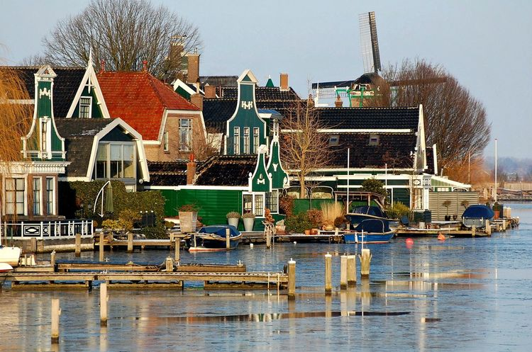 Architecture Building Exterior Built Structure Cottage Day Development Dutch Green Color Harbor Holland House Netherlands No People Outdoors Residential District Residential Structure River Riverbank Sea Sky Town Village Water Waterfront Zaanse Schans