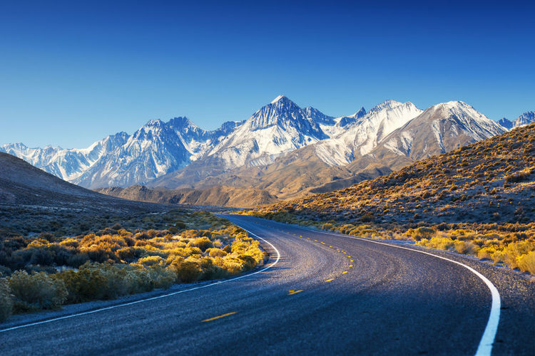 Road in California desert mountains - USA Asphalt Beautiful California Death Valley Desert Hot Road Beauty In Nature Blue Contrast Freeway Highway Landscape Mountain Mountain Range Mountains Nature No People Peaceful Road Scenery Scenics Snow Sun Transportation