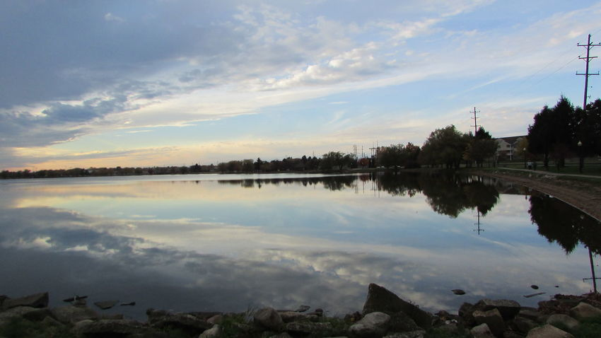 Evening On The Lake Rocky Shore Taking Photos Power Lines Water Reflections Love This Spot Cool Clouds Lake Cadillac Pure Michigan