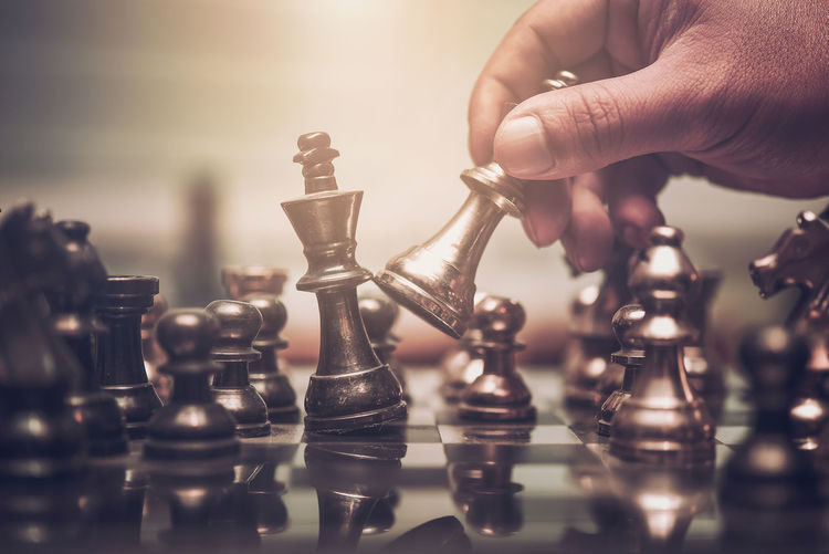Close-up of hand playing chess