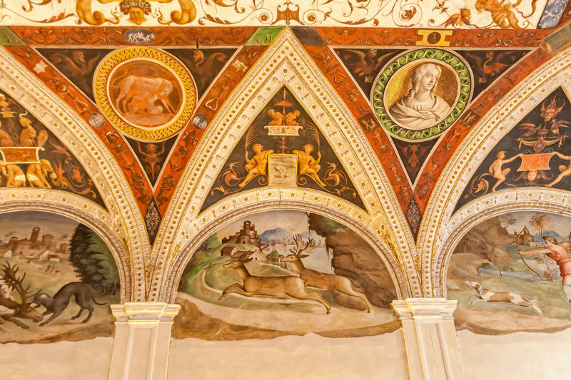 Mantua, Italy - January 4 2019: Frescos on the walls of the Gonzaga castle, hunting scenes Architecture Built Structure History The Past Craft Ornate Carving - Craft Product Pattern Representation Design Low Angle View Travel Destinations Architectural Feature Indoors  Human Representation Arch Architectural Column Mural Fresco Architecture And Art Carving Mantua Italy Frescos