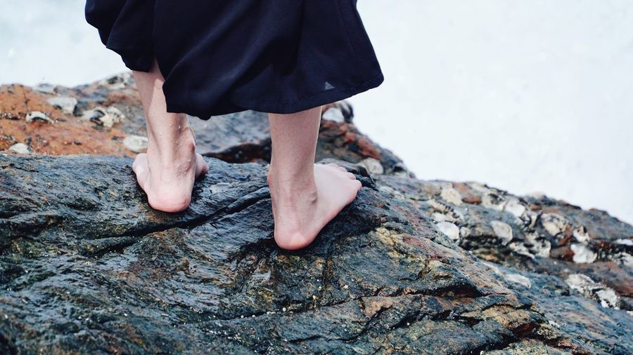 On the wet rock. Rock Sea Wet Foot Low Section Limb Human Leg One Man Only Only Men Adult Barefoot One Person Human Body Part Beach Outdoors Day Close-up
