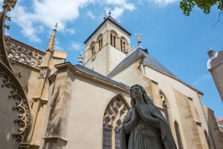 Sculpture Of Virgin Mary Against Church Of Saint-Eucaire