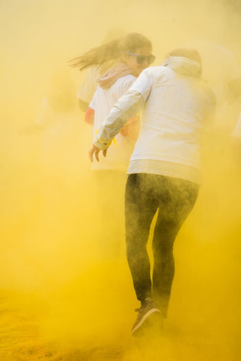 Rear view of people during holi