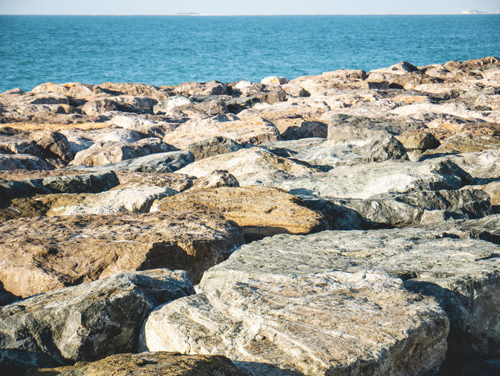 Dubai Palm Jumeirah Outdoors Nature Water Rock Stone Stone Material Landscape Sunlight Horizon Over Water Sea Seascape Horizon Rock Formation Eroded Rocky Coastline Beauty In Nature Rock - Object Land