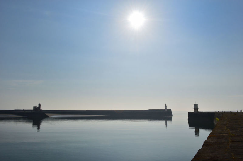 Calm Cumbria Harbour Lighthouse Pier SAFE HAVEN Architecture Beauty In Nature Calm Sea Clear Sky Harbour Wall Lens Flare Nature Outdoors Pier Reflection Scenics - Nature Sky Sun Sunlight Tranquil Scene Tranquility Water Whitehaven Whitehaven Habour