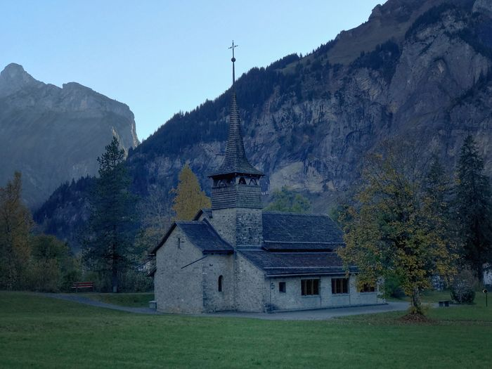 Serenity Shade Steeple Kandersteg Suisse  Switzerland Backdrop Church Mountain Architecture Building Exterior Built Structure No People Outdoors Scenics Mountain Range Tranquil Scene Grass Nature Place Of Worship Beauty In Nature Sky Day Tree Landscape Tranquility EyeEmNewHere