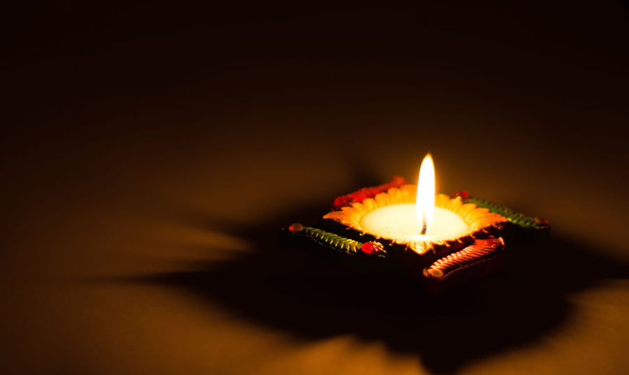 Decorative Lamps lit in the Indian festival of Diwali Diwali Diwali Diya Diwali Diyas Festival Lamps Indian Religious Culture Religious Festival Candle Flame Candle Light Diwali Celebration Diwali Lights Diya Diyas Indian Festival Indian Festive Season Lamp Lamps