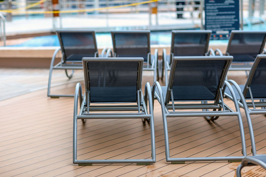 On the deck Chair Cruise Cruise Ship Cruising Deck Deck Chairs Freedom Of The Seas In A Row No People On The Deck Pool Pool Deck Poolside Relax Relaxing Seat Swimming Pool